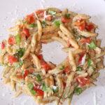 Is Malloreddus integrali con patè di olive e pomodorini